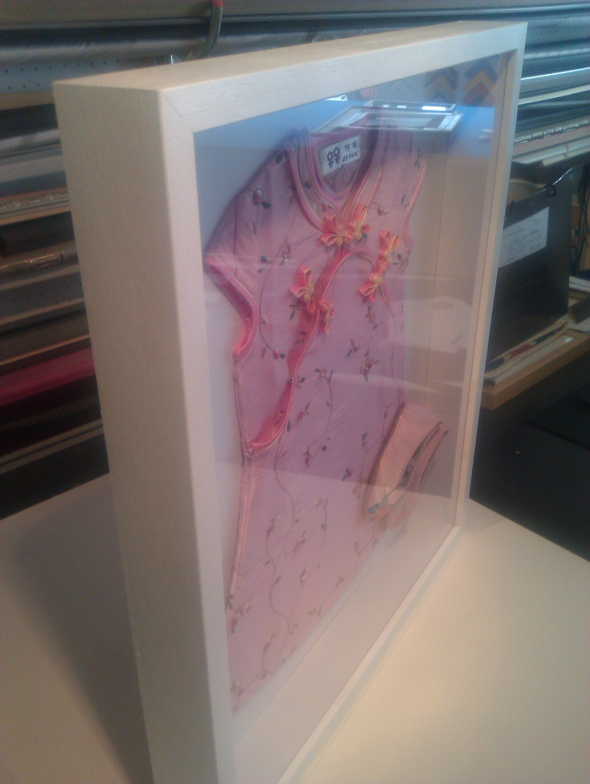 Dress stretched and slippers displayed in box frame