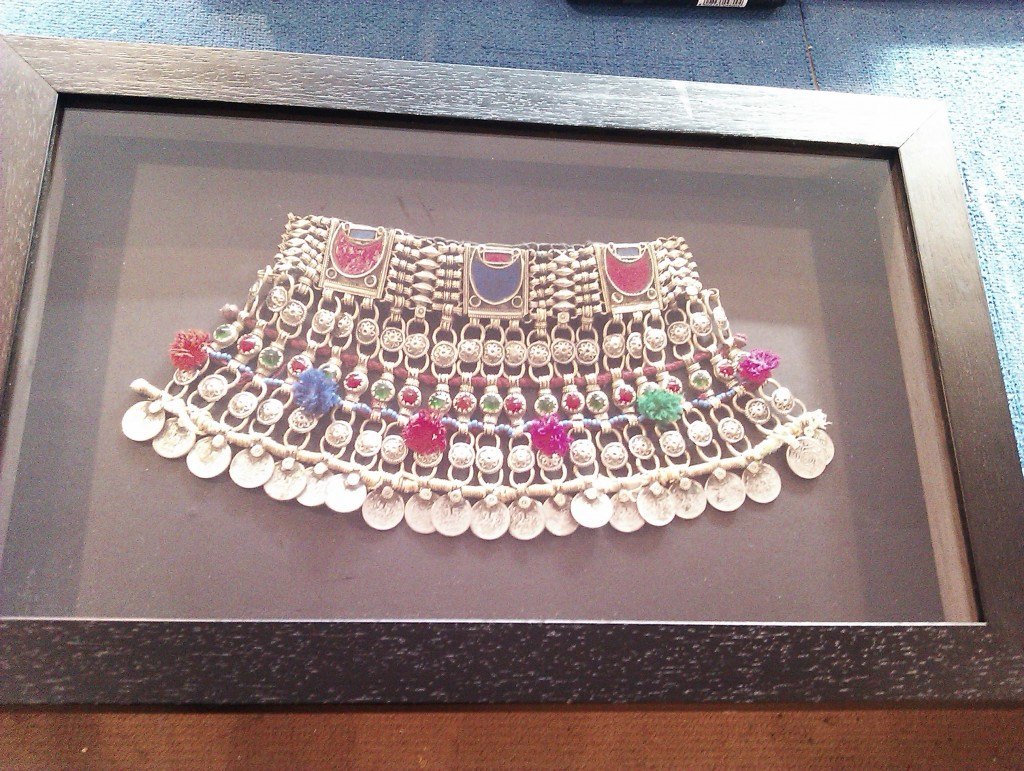 Necklace displayed in box frame